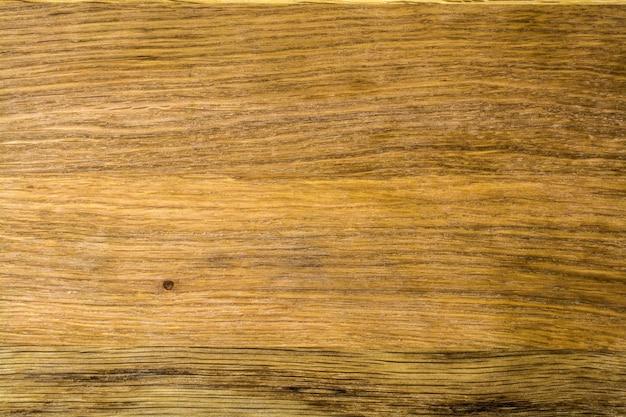 ブラウンオーク色のクローズアップのダークウッドパネルの質感。
