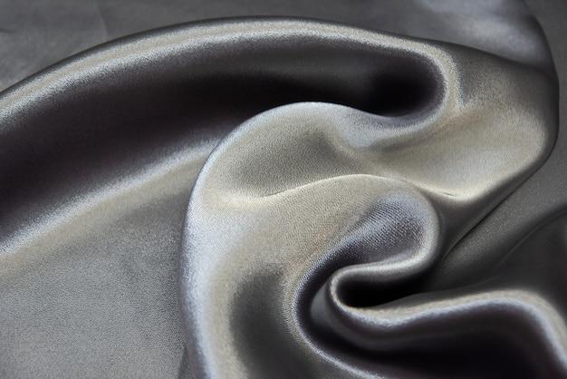 Текстура шелковой ткани серебристо-голубая. шифон. фон, узор.