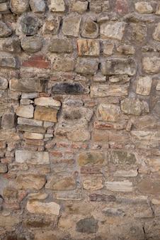 石の壁の質感。積み重ねられた石の背景。