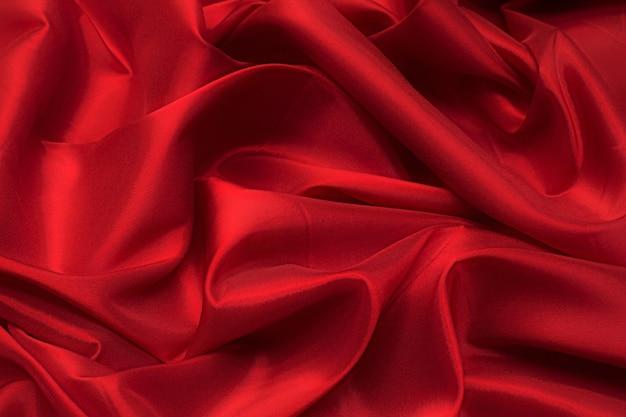 Текстура синтетической ткани красного цвета. фон, узор.