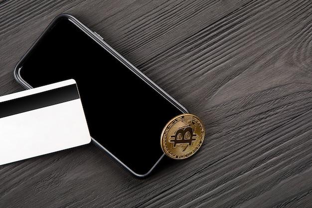 スマートフォンでウォレットからビットコインへのドルの送金。ブロックチェーン。