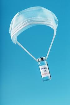 Covidウイルスに対するワクチンは、医療用マスクからスクレーパーの空きスペースを飛ぶ