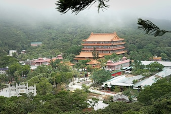 The view of temple near Big Buddha statue in Hong Kong in a foggy day.