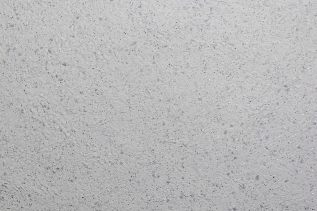 Стена покрыта красивой фактурной штукатуркой с блестками. вариант отделки.