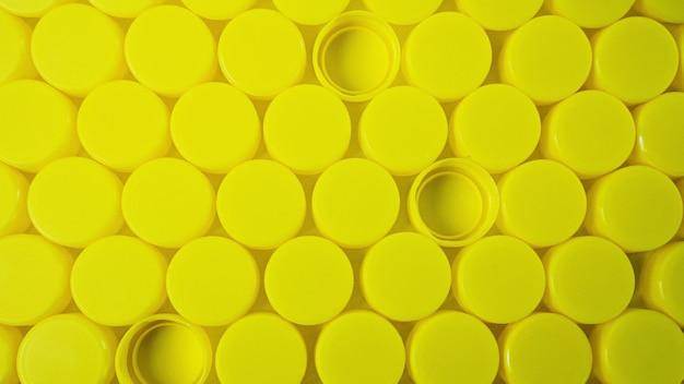 노란색 병 플라스틱 캡 배경