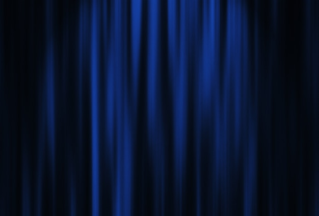 スポット照明付きの劇場の赤いカーテン