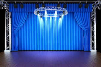 Theater stage with blue curtains and spotlights