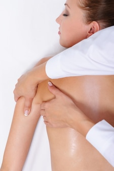 Therapeutic massage for  female back and shoulder - lying down on bed