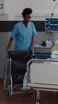 Therapist doctor monitoring heart pulse during medical recovery in hospital ward