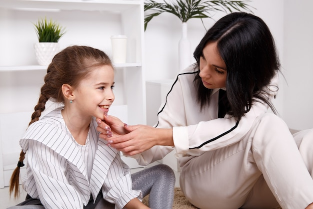 Therapist session concept. female psychologist working with cute little child.