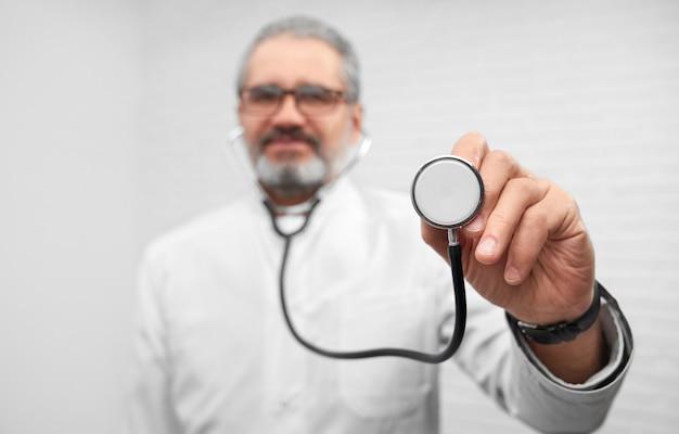 Therapist showing stethoscope, posing.
