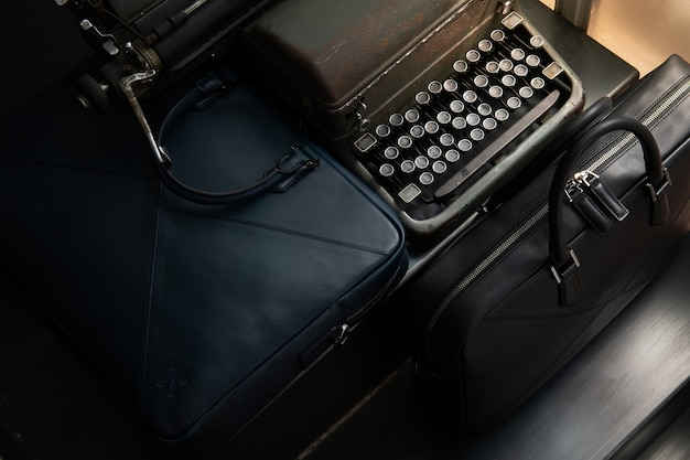 There are old typewriters and bags on the black stairs