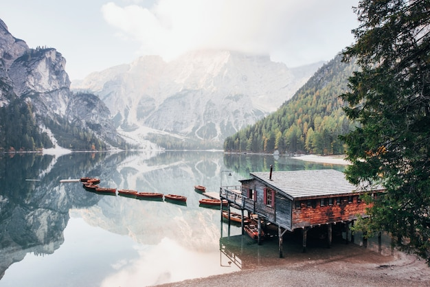There is no people at this moment. good landscape with mountains. touristic place with wooden building and pear