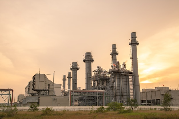 Thermal power plant for industrial estate on sunset.