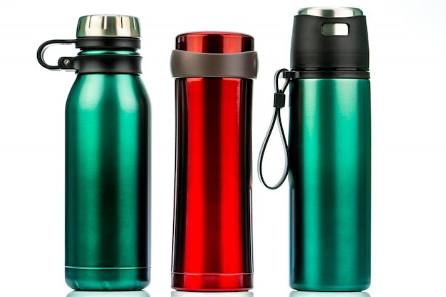 Thermos bottle isolated. coffee or tea reusable bottle container. thermos travel tumbler. red and green stainless steel thermos water flask.