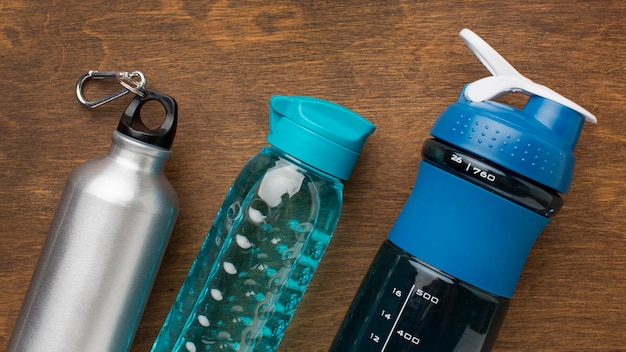 Thermos and fitness bottles of water