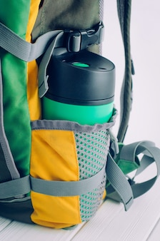 Thermos mug in the backpack side pocket