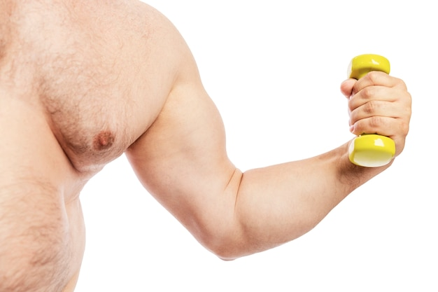Thick hairy male torso with dumbbell in hand.