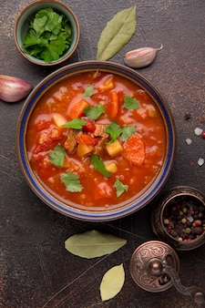 Thick tomato soup with meat, cereals and vegetables