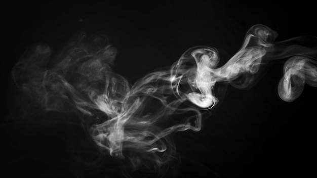 A thick twirling smoke pattern in front of black background