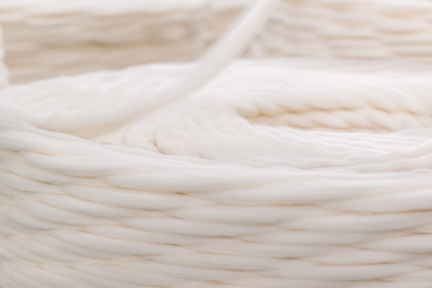 Thick white thread twisted into a coil. closeup
