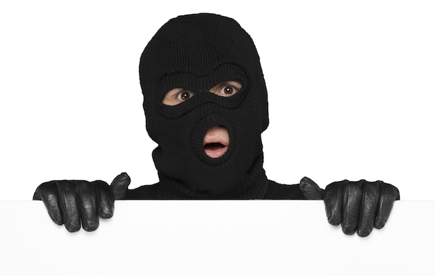 Thief hiding behind an empty white sign with space for text isolated on white background
