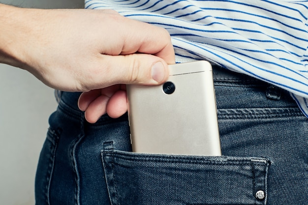 Thief steal smartphone from back pocket jeans