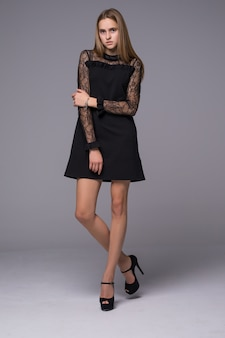 Thin figure girl dressed in black silk dress with lace