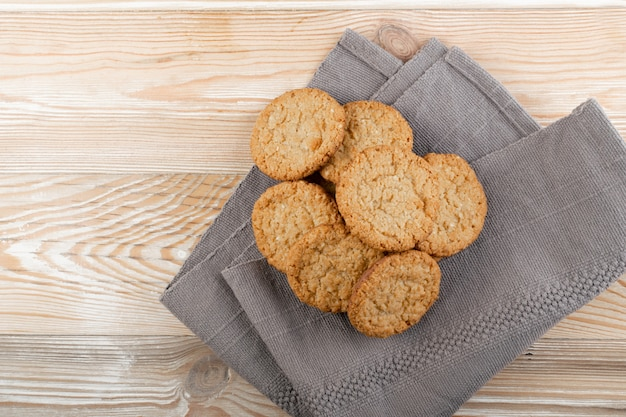 Thin oatmeal cookies, healthy cereal crackers with chocolate