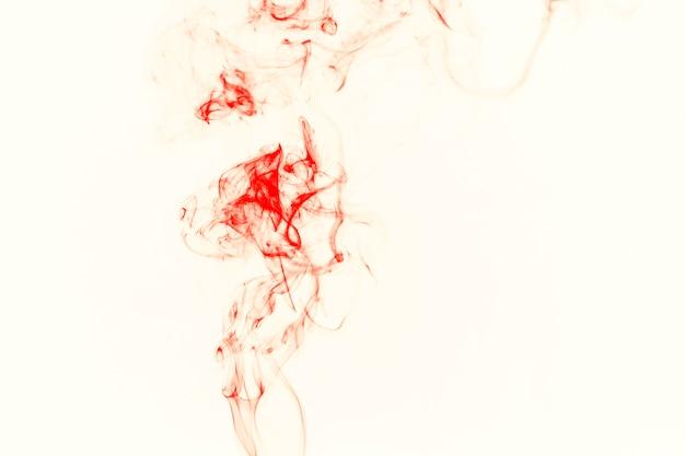 薄い橙色の煙