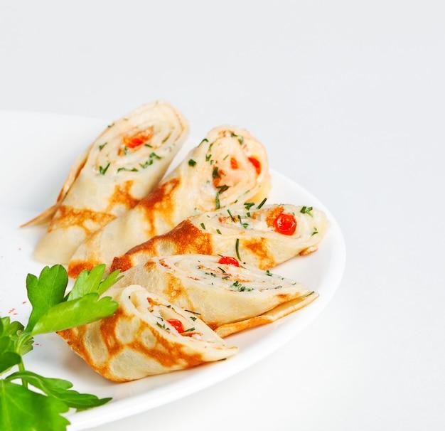 Thin pancakes with caviar