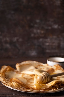 Thin pancakes with honey. text space