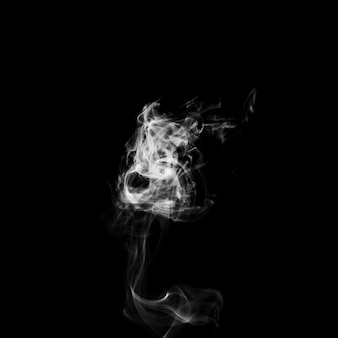 薄い渦巻く煙
