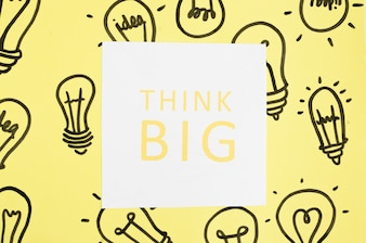 Think big text on hand drawn light bulb over the yellow background