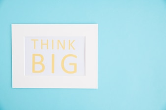 Think big text white frame on blue background