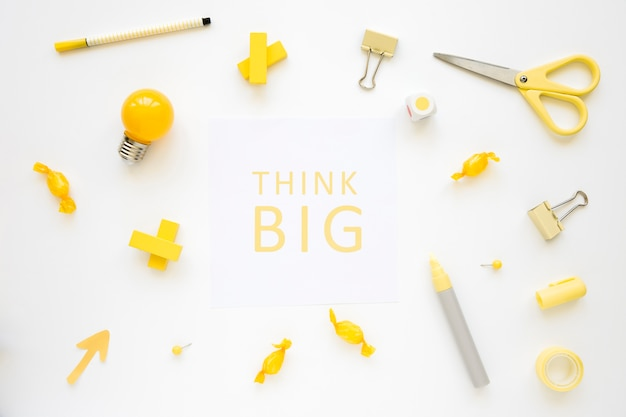 Think big words surrounded by various electric bulb, candies and stationeries