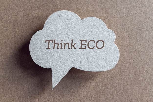 Think ecologically concept, speech bubble of recycled cardboard