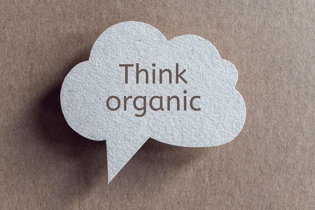 Think organic phrase written on cardboard speech bubble