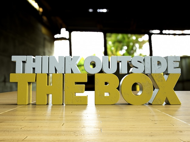 Think outside the box motivational 3d text over a wooden table