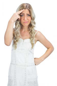Thinking blonde having interrogative posture