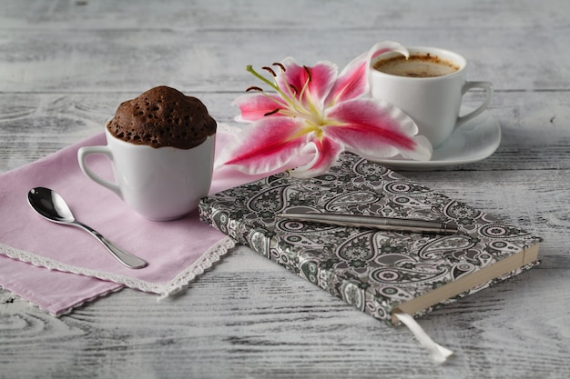 Thinking in coffee time with teacup cupcake