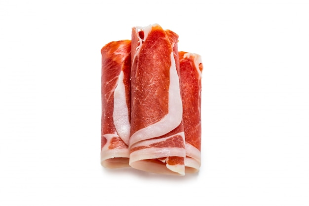Thinly sliced jamon isolated on white.