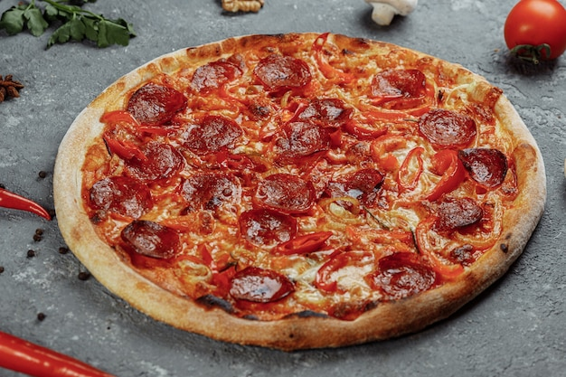 Thinly sliced pepperoni is a popular pizza topping in american-style pizzerias.