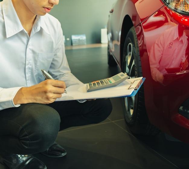 This career salesman calculating on calculator