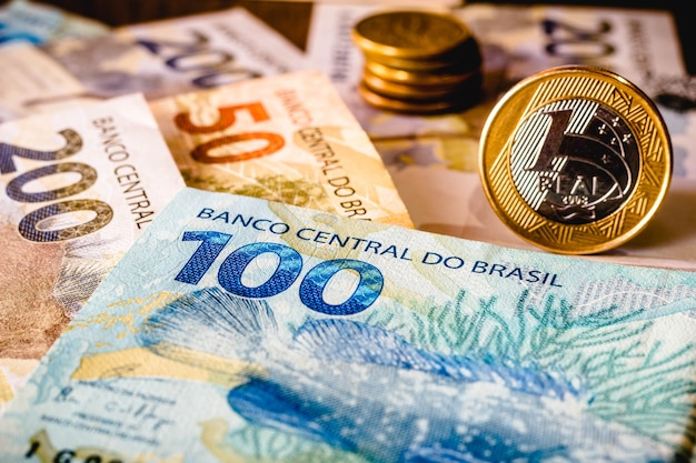 In this photo illustration being displayed fifty, one hundred and two hundred reais bills and a one reais coin highlighted. the real is the current money in brazil.