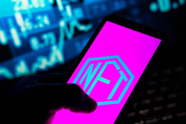 In this photo illustration the nonfungible token nft logo seen displayed on a smartphone