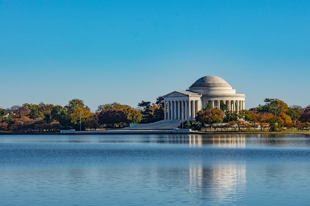Thomas jefferson memorial surrounded by the lake and trees under the sunlight in washington dc