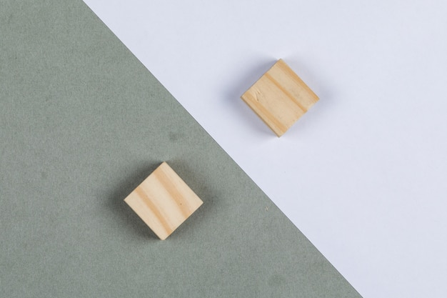 Thought difference concept with wooden blocks on navy green and white background top view. horizontal image