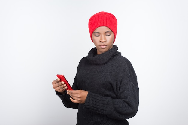 Thoughtful african american woman holding modern phone