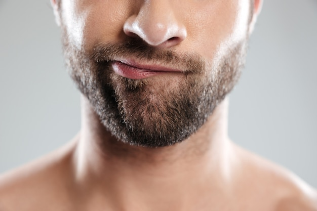 Thoughtful bearded mans face isolated